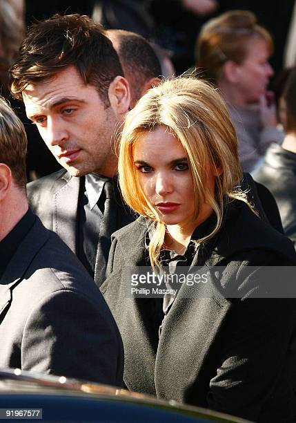 Westlife's Mark Feehily and Jodi Albert attends the funeral of Boyzone member Stephen Gately on October 17 2009 in Dublin Ireland