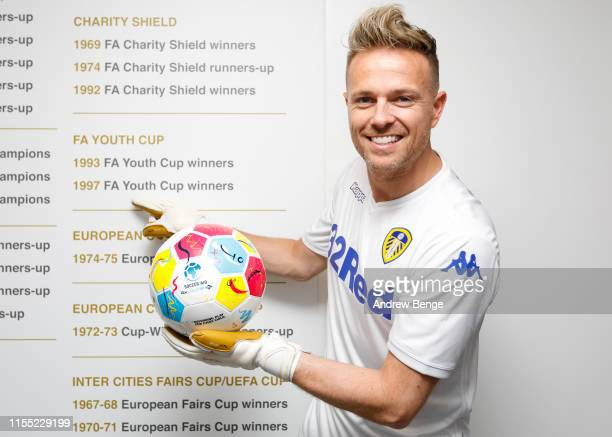 Westlife's Nicky Byrne points to the FA Youth Cup tournament he won with Leeds United as he trains with his son Rocco ahead of the Soccer Aid match...