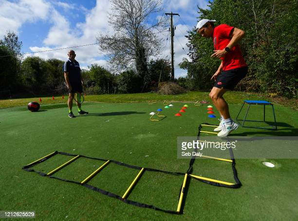 Westmeath , Ireland - 11 May 2020; Irish No.1 ranked tennis player and Davis Cup team member Simon Carr with his physical trainer and father Tommy...