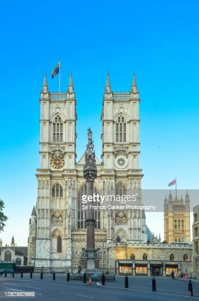 westminster abbey facade at early dusk in london, england, uk - westminster abbey stock pictures, royalty-free photos & images