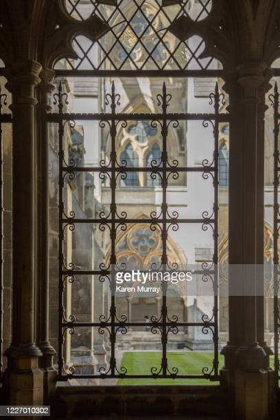 westminster abbey view through ironwork window - westminster abbey stock pictures, royalty-free photos & images