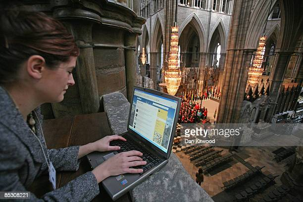 Westminster Abbey's online editor Imogen Levy uses the micro blog site 'Twitter' during rehearsals ahead of the Commonwealth Observance at...