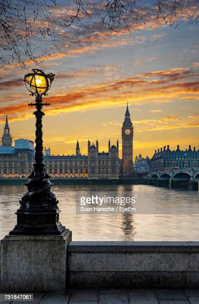 Westminster Bridge By Big Ben Over Thames River Against Sky During Sunset In City