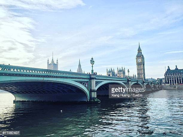 westminster bridge over thames river against sky - nottingham stock pictures, royalty-free photos & images