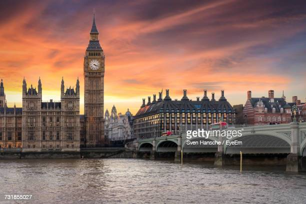 Westminster Bridge Over Thames River By Big Ben Against Cloudy Sky During Sunset In City