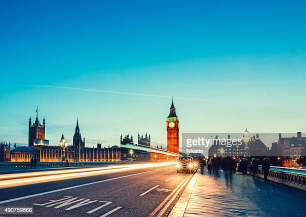 westminster bridge with big ben in london - houses of parliament london stock photos and pictures
