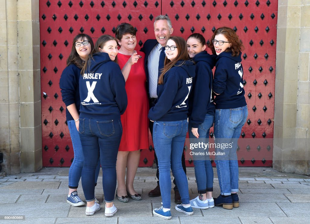 DUP Westminster candidate Ian Paisley Junior jokes with DUP leader Arlene Foster as they are pictured with some of Paisley Junior's election canvassers after the Democratic Unionist party manifesto launch at the Old Courthouse on May 31, 2017 in Antrim, Northern Ireland. Candidates for the general election face an uncertain campaign against the backdrop of Brexit, Northern Ireland provides the only hard border between the UK and Europe and also the Stormont Assembly's ongoing stalemate due to the political deadlock between the local parties.