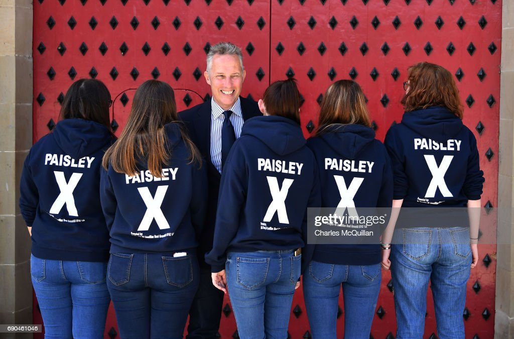 DUP Westminster candidate Ian Paisley Junior winks at a party member as he is pictured with some of his election canvassers as the Democratic Unionist party launch their manifesto at the Old Courthouse on May 31, 2017 in Antrim, Northern Ireland. Candidates for the general election face an uncertain campaign against the backdrop of Brexit, Northern Ireland provides the only hard border between the UK and Europe and also the Stormont Assembly's ongoing stalemate due to the political deadlock between the local parties.