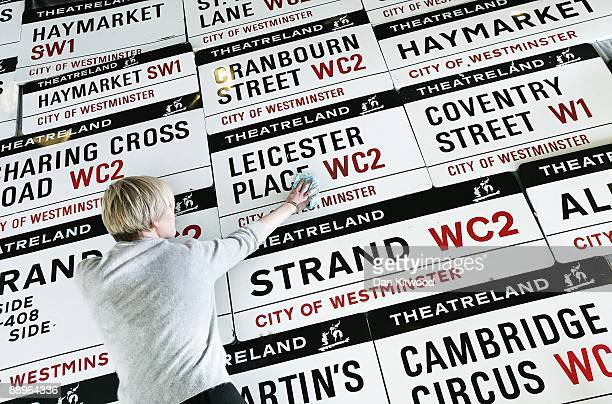 Westminster City Council employee cleans road signs on July 10 2009 in London England The council are replacing more than 90 signs in the heart of...