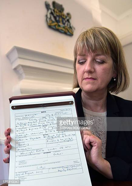 Westminster City Council registrar Alison Cathcart holds a copy of the birth certificate for Prince George of Cambridge after the birth registration...