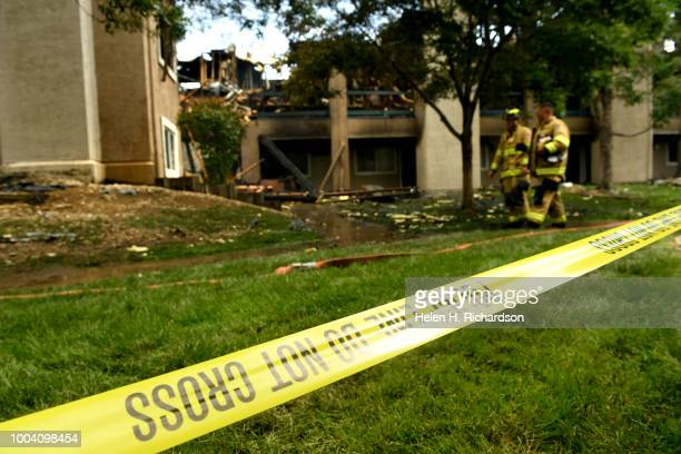 Westminster firefighters look for hotspots at the scene of a deadly apartment complex fire at the Westbury Apartments on July 22 in Westminster...
