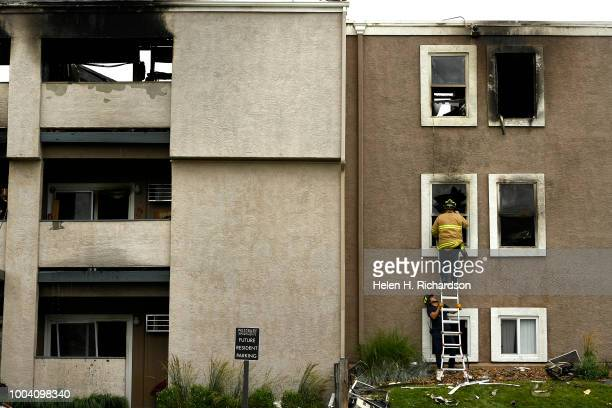 Westminster firefighters search a second story apartment for animals at the scene of a deadly apartment complex fire at the Westbury Apartments on...