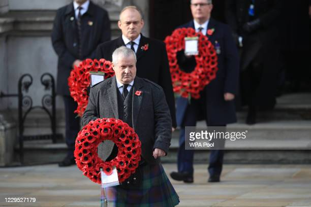 Westminster leader Ian Blackford and Liberal Democrat leader Ed Davey carry wreaths during a National Service of Remembrance at the Cenotaph in...