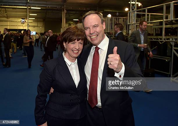 Westminster leader Nigel Dodds gives a thumbs up as he stands beside his wife Diane Dodds as the General Election count takes place at the King's...