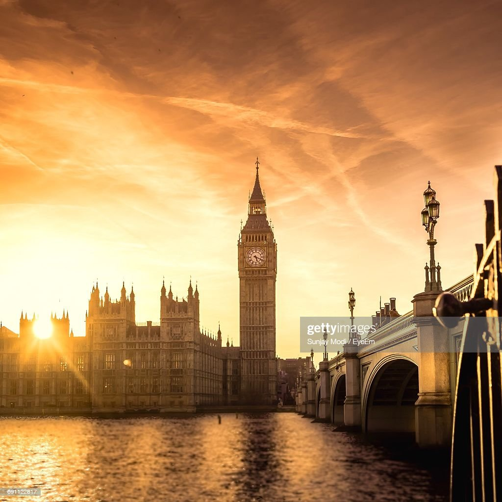 Westminster Palace And Bridge With Thames River In City Against Sky : Stock Photo