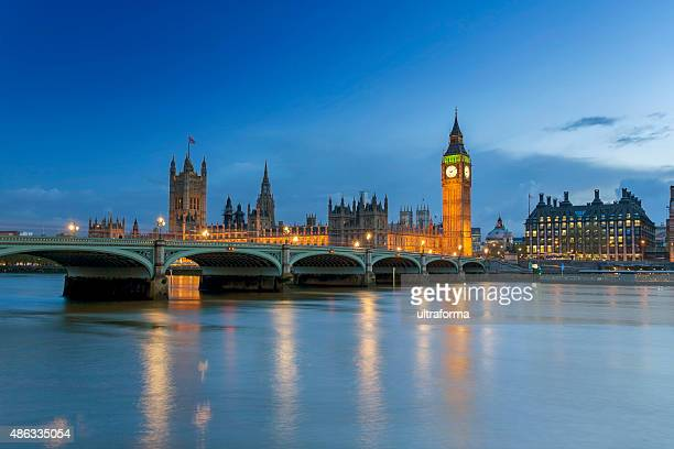 westminster palace in london at dusk - london stock pictures, royalty-free photos & images