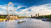 Westminster Parliament, Big Ben and the Thames with blue sky