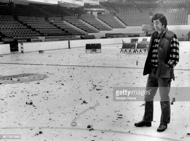Weston Adams, owner of the Boston Garden, looks at debris thrown onto ice after a crowd waiting in line to purchase advance tickets to a Led Zeppelin...