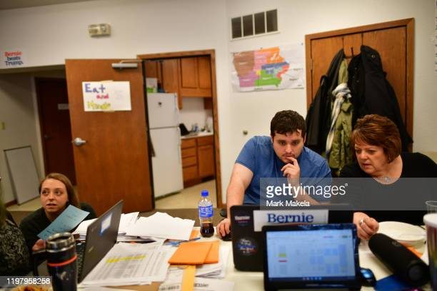 Weston Buhr a field office organizer works o this laptop with a volunteer at a Bernie Sanders field office on February 1 2020 in Waterloo Iowa On the...