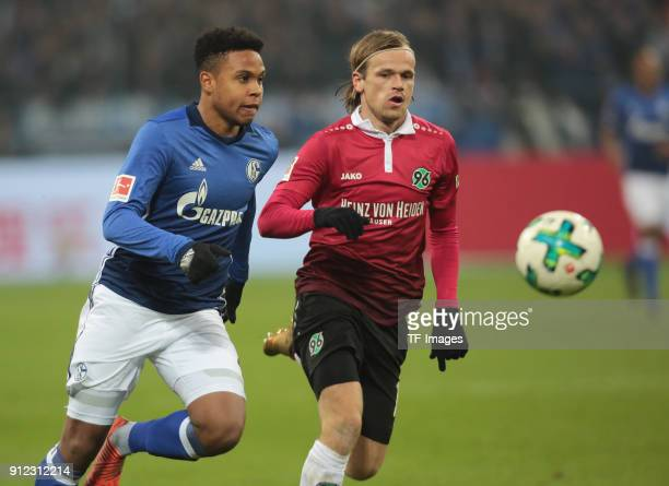 Weston James Earl McKennie of Schalke and Iver Fossum of Hannover battle for the ball during the Bundesliga match between FC Schalke 04 and Hannover...