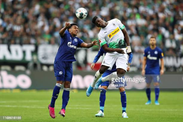 Weston McKennie of FC Schalke 04 and Breel Embolo of Borussia Monchengladbach jump for a header during the Bundesliga match between Borussia...