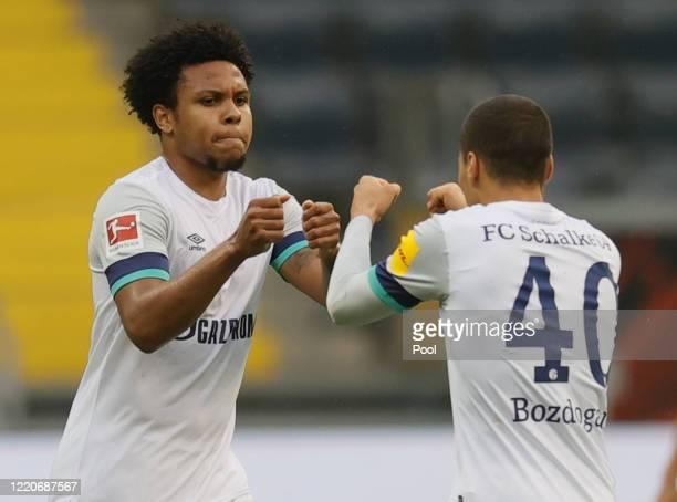 Weston McKennie of FC Schalke 04 celebrates after scoring his team's first goal with team mate Can Bozdogan during the Bundesliga match between...
