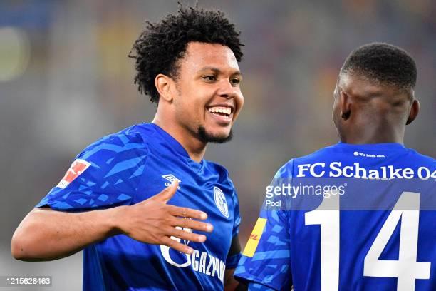 Weston McKennie of FC Schalke 04 celebrates with Rabbi Matondo after scoring his team's first goal during the Bundesliga match between Fortuna...