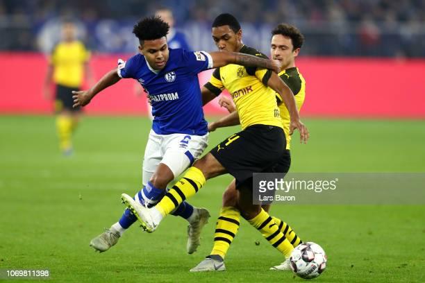Weston McKennie of FC Schalke 04 is challenged by Abdou Diallo of Borussia Dortmund during the Bundesliga match between FC Schalke 04 and Borussia...