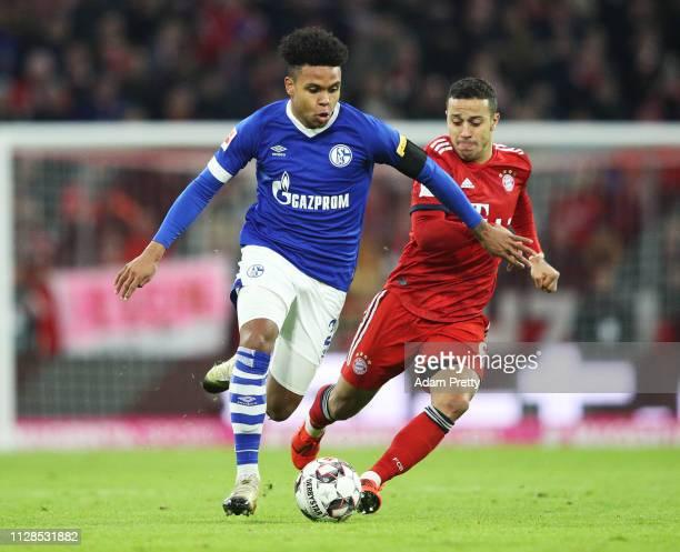 Weston McKennie of FC Schalke 04 is challenged by Thiago of FC Bayern Muenchen during the Bundesliga match between FC Bayern Muenchen and FC Schalke...