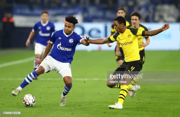 Weston McKennie of FC Schalke shoots is challenged by Abdou Diallo of Borussia Dortmund during the Bundesliga match between FC Schalke 04 and...