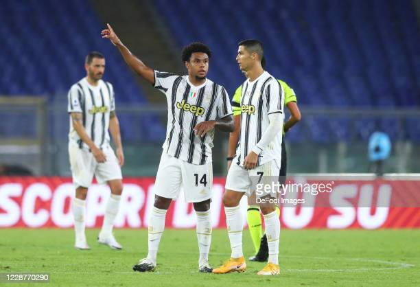 Weston McKennie of Juventus and Cristiano Ronaldo of Juventus gesture during the Serie A match between AS Roma and Juventus at Olimpico on September...