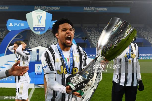 Weston McKennie of Juventus celebrates with the PS5 Supercup after victory in the Italian PS5 Supercup match between Juventus and SSC Napoli at Mapei...