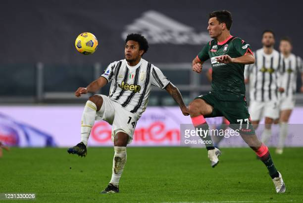 Weston McKennie of Juventus challenged by Milos Vulic of FC Crotone during the Serie A match between Juventus and FC Crotone at Allianz Stadium on...