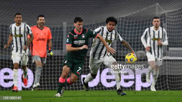 Weston McKennie of Juventus evades challenge from Milos Vulic of FC Crotone during the Serie A match between Juventus and FC Crotone at Allianz...