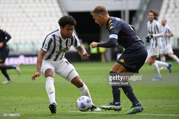 Weston McKennie of Juventus FC against Domenico Criscito of Genoa CFC during the Serie A match between Juventus and Genoa CFC at Allianz Stadium on...