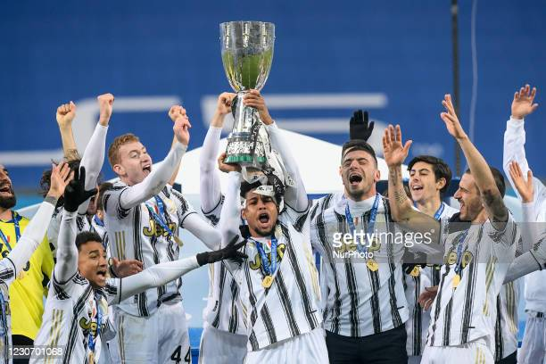 Weston McKennie of Juventus FC and his teammates celebrate after winning the Italian Super Cup Final match between FC Juventus and SSC Napoli at the...