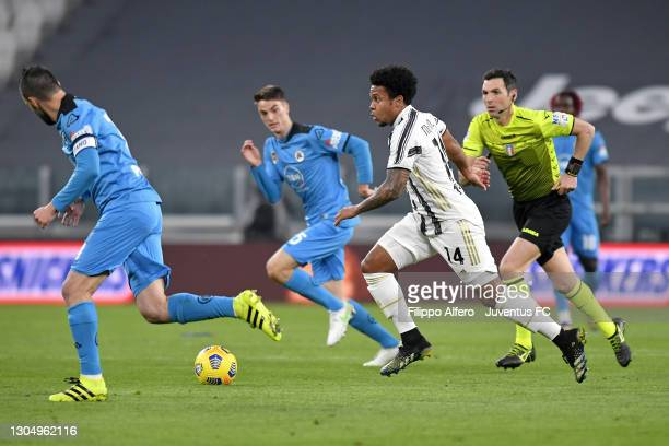 Weston McKennie of Juventus is challenged by Claudio Terzi and Giulio Maggiore of AC Spezia during the Serie A match between Juventus and Spezia...