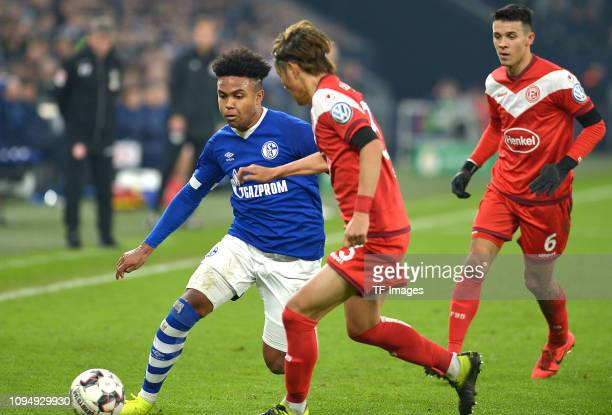 Weston McKennie of Schalke 04 Takashi Usami of Fortuna Duesseldorf and Alfredo Morales of Fortuna Duesseldorf battle for the ball during the DFB...