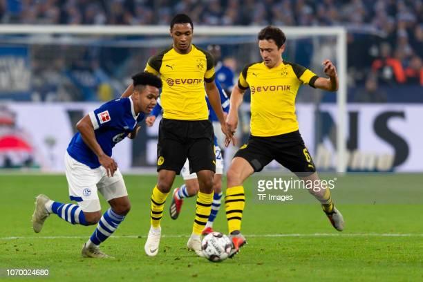 Weston McKennie of Schalke Abdou Diallo of Dortmund and Thomas Delaney of Dortmund battle for the ball during the Bundesliga match between FC Schalke...