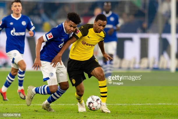 Weston McKennie of Schalke and Abdou Diallo of Dortmund battle for the ball during the Bundesliga match between FC Schalke 04 and Borussia Dortmund...