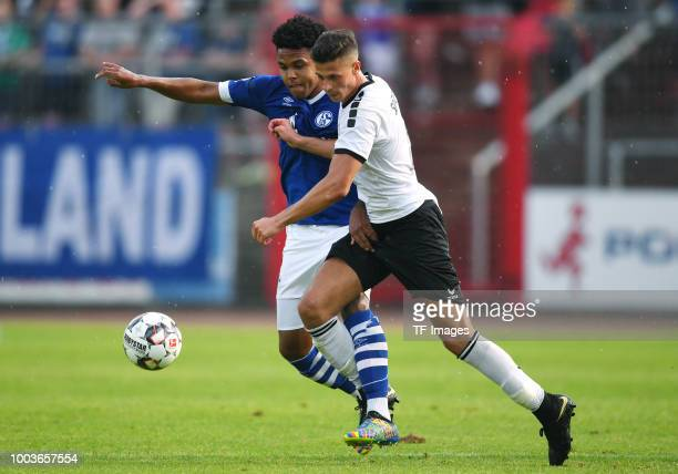 Weston McKennie of Schalke and Alessandro Tomasello of Schwarz Weiss Essen battle for the ball during the Friendly match between Schwarz Weiss Essen...
