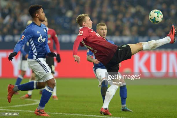 Weston McKennie of Schalke and Felix Klaus of Hannover battle for the ball during the Bundesliga match between FC Schalke 04 and Hannover 96 at...