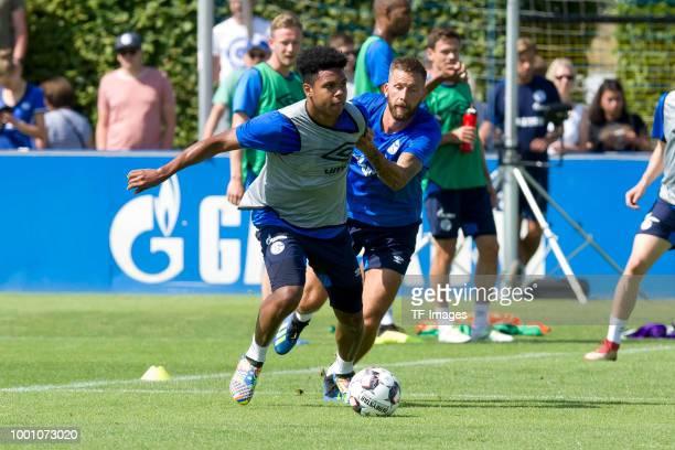 Weston McKennie of Schalke and Guido Burgstaller of Schalke battle for the ball during a training session at the FC Schalke 04 Training center on...