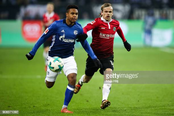 Weston McKennie of Schalke and Iver Fossum of Hannover 96 battle for the ball during the Bundesliga match between FC Schalke 04 and Hannover 96 at...