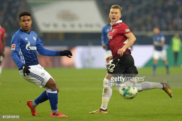 Weston McKennie of Schalke and Matthias Ostrzolek of Hannover battle for the ball during the Bundesliga match between FC Schalke 04 and Hannover 96...