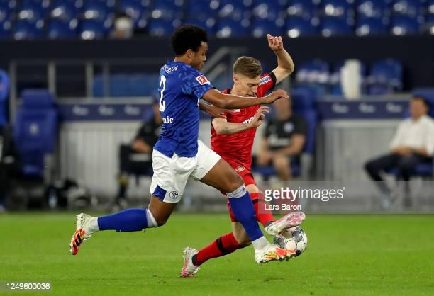 Weston McKennie of Schalke challenges Mitchell Weiser of Leverkusen during the Bundesliga match between FC Schalke 04 and Bayer 04 Leverkusen at...