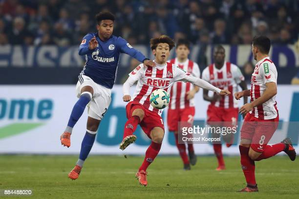 Weston McKennie of Schalke fights for the ball with Yuya Osako of Koeln during the Bundesliga match between FC Schalke 04 and 1 FC Koeln at...