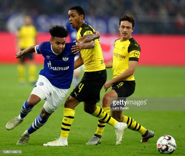Weston McKennie of Schalke is challenged by Abdou Lakhad Diallo of Dortmund during the Bundesliga match between FC Schalke 04 and Borussia Dortmund...