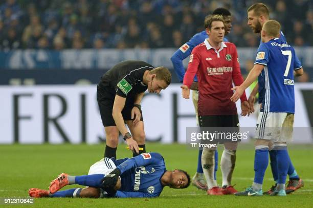 Weston McKennie of Schalke lays injured on the ground during the Bundesliga match between FC Schalke 04 and Hannover 96 at VeltinsArena on January 21...