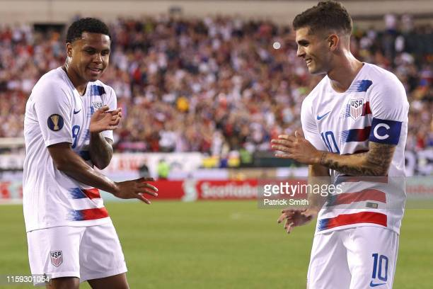 Weston Mckennie of the United States celebrates his goal with teammate Christian Pulisic against Curacao during the first half of the CONCACAF Gold...